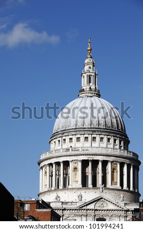 The dome of St. Paul Cathedral in London, England against a blue sky.