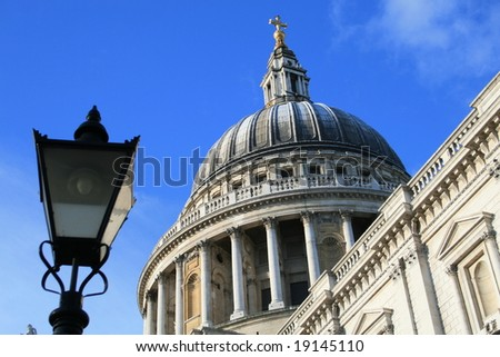 The dome of St. Pauls Cathedral, London, with an out of focus gaslamp in the foreground.