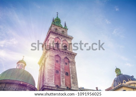 The dome of the Assumption Church and Korniakt Tower in Lviv. Ukraine #1091956025