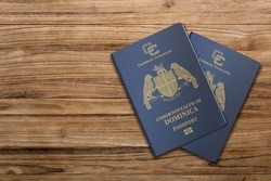 The Dominica passport is issued to citizens of the Commonwealth of Dominica for international travel,Dominica passport on a wooden background