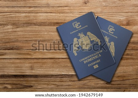 The Dominica passport is issued to citizens of the Commonwealth of Dominica for international travel,Dominica passport on a wooden background  Stockfoto ©
