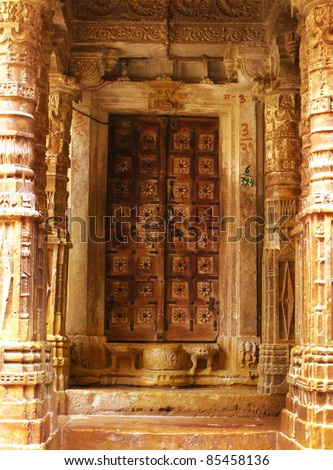 "The door of an ancient jainist temple in Jaisalmer, the magnificent ""Golden City"" in the heart of Rajasthan (India), surrounded by the desert of Thar."