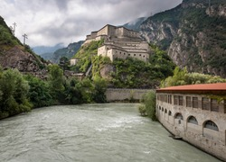 the Dora Baltea river in Hone town and a view of the Bard fortress, Aosta Valley, Italy