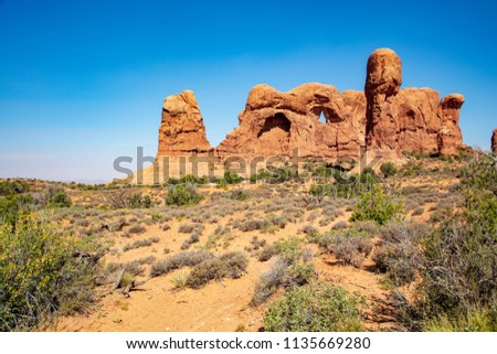 The Double Arch formation along The Windows Trail in Arches National Park #1135669280