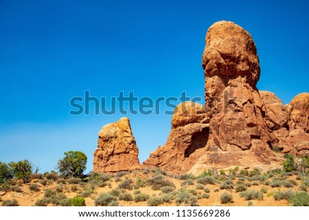 The Double Arch formation along The Windows Trail in Arches National Park #1135669286