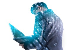The double exposure image of the business man using a laptop computer during sunrise overlay with computer's keyboard image. The concept of modern life, business, city life and internet of things.