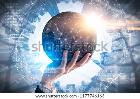 The double exposure image of the businessman hold the virtual hologram on hand and element of this image furnished by Nasa. the concept of communication network, internet of things and future life