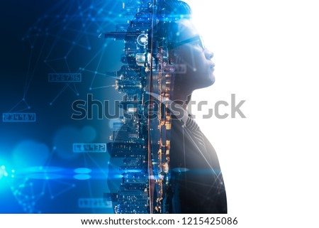 The double exposure image of the businessman thinking overlay with cityscape image and futuristic hologram. The concept of modern life, business, city life and internet of things. #1215425086