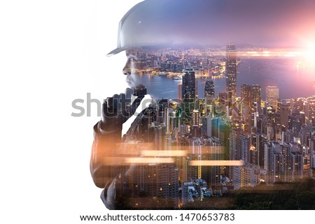 The double exposure image of the engineer thinking overlay with cityscape image and. The concept of engineering, construction, city life and future. Stock photo ©