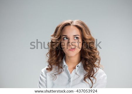 The doubting woman on gray background Сток-фото ©