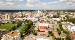 The downtown city skyline and buidlings of Sprigfield MO under partly cloudy skies aerial perspective