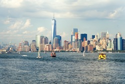 The downtown Manhattan skyline seen from the ocean with boats on the New York Harbor