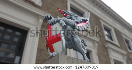 The dragon boundary marks are cast iron statues of dragons on metal or stone plinths that mark the boundaries of the City of London.  #1247809819