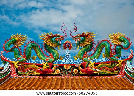 The Dragon status on roof of joss house - stock photo