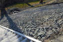 The drainage chute to the sewer and the slope is reinforced from washouts with gabions. A grid filled with stones