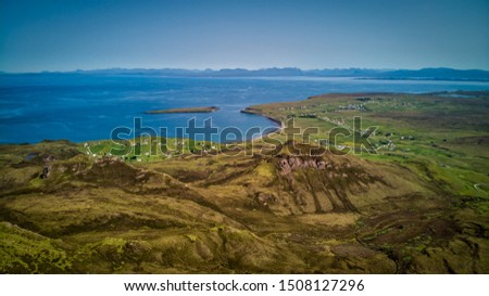 The dramatic landscape of the Quiraing. View from the cliffs to the sea #1508127296