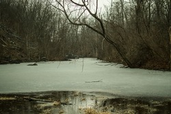 The dreary landscape of an abandoned quarry on a wet winter day