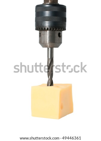 The drill makes a hole in the cheese
