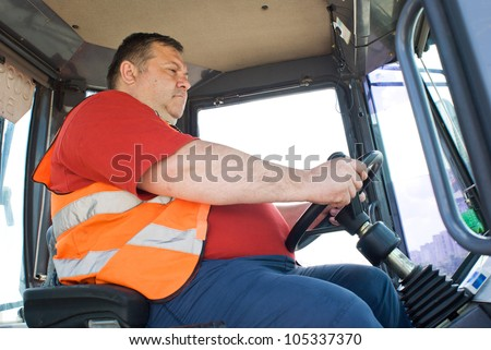 The driver working in the cabin of the truck