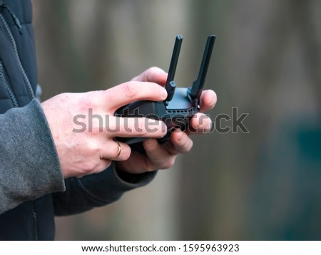 The dron control panel in the hands of a man. Technology. Place for text. Background image.