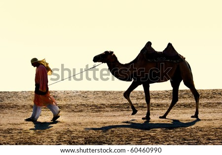 The drover with a camel go on wilderness - stock photo