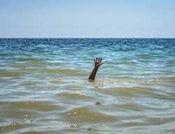The drowning hand stretched out over the surface for help