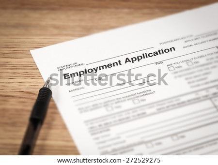 The drudges of filling in an application for employment.
