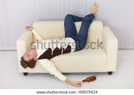 The drunk person funny sleeps on the sofa