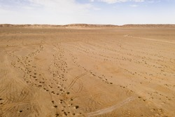 The dry land, vast flat land.