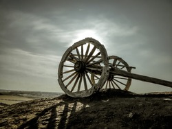 The dry screeching wheels of the horse carriage in the cold lonely desert.