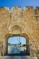 The Dung Gate or Mughrabi Gate, one of the Old City Gates of Jerusalem, built by the Ottomans southwest of the Temple Mount, with the arches of the main entrance to the Western Wall Plaza behind it