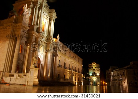 The Duomo, Ortigia, Sicily, on a rain-soaked morning before first light. In the background is the Church of Saint Lucia.
