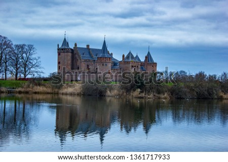 "The Dutch castle ""Muiderslot"". The castle is surrounded by grass lands, from these lands you have this view. #1361717933"
