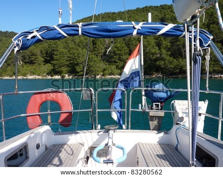 The dutch flag on a sailing yacht in a bay of an island in the Adriatic sea of Croatia