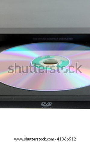 The dvd player with a disk, on a white background, is isolated.