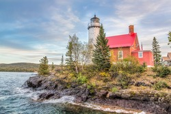 The Eagle Harbor Light, perched on a rocky outcropping, stands on the Lake Superior coast of northwestern Michigan's Keweenaw Peninsula.