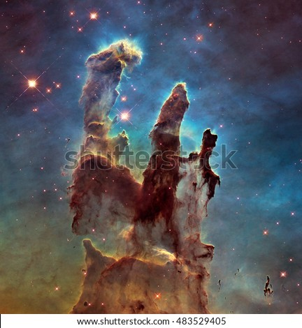 The Eagle Nebulaas Pillars of Creation. This image shows the pillars as seen in visible light, capturing the multi-coloured glow of gas clouds, Elements of this image are furnished by NASA.
