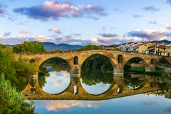 The Early Blue Hour on a Cloudy Evening over the Iconic Bridge in Puente la Reina, along the French Way of St James Camino de Santiago Pilgrim Trail