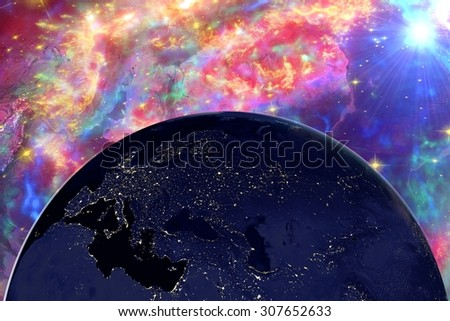 The Earth from space showing Europe in night on surrealistic background with galaxies, elements of this image furnished by NASA, other orientations available