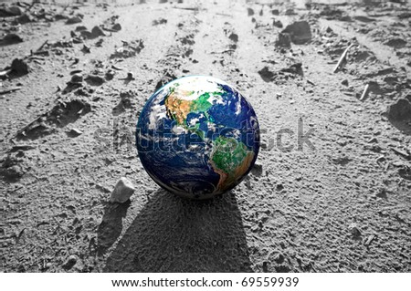 The Earth globe on rocky Mars like surface. Concepts of Earth protection, environment, global warming, disasters etc.