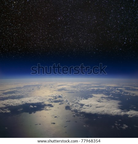 The Earth in space. High altitude view of the surface against the starry night sky.