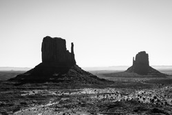 The East and West Mitten Buttes in Silhouette, Monument Valley, Arizona, Navajo Nation