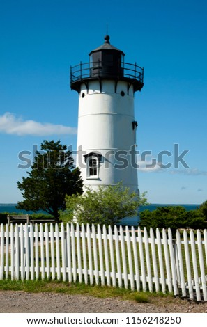 The East Chop lighthouse tower, an island beacon on Martha's Vineyard, is constructed of cast iron. It is a favorite attraction for tourists. #1156248250