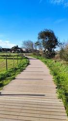 The Ecovia do Cavado e do Homem (Cavado and Man's Ecoway) pathway at the Northern Litoral Natural Park in Fao, Esposende, Portugal. The large estuary of the Cávado river.