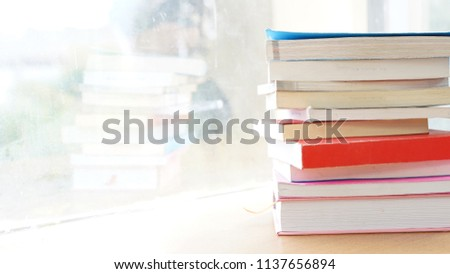 The education and wisdom concept, stack of books, shelves, knowledge, study, students by the window natural light #1137656894