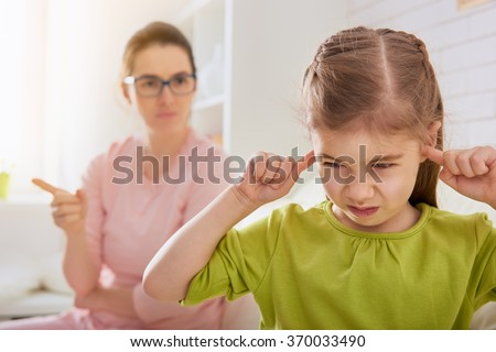 the education of the child. mother scolds her child girl. family relationships #370033490