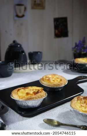 The egg tart is a kind of custard tart found in Cantonese cuisine derived from the English custard tart and Portuguese pastel de nata.The dish consists of an outer pastry crust filled with egg custard