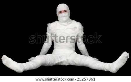 The Egyptian mummy sitting on a black background