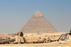 The Egyptian pyramids and Sphinx are ancient stone structures located in Egypt. Giza Valley Cairo is one of the Seven Wonders of the World.