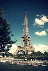 the Eiffel Tower and a boat with tourists on the river Seine in Paris at a summer day, Vintage Style, France, Eiffelturm und ein Ausflugsschiff auf der Seine in Paris an einem Sommertag, Frankreich,